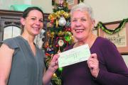 Jo Coady, left, senior territory manager of the Oxford Mail, presents Susan Hodgkins with her cheque