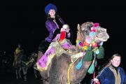 Katie Whiteley on one of the camels