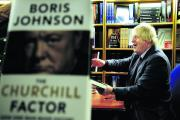 Boris Johnson with copies of his new book The Churchill Factor