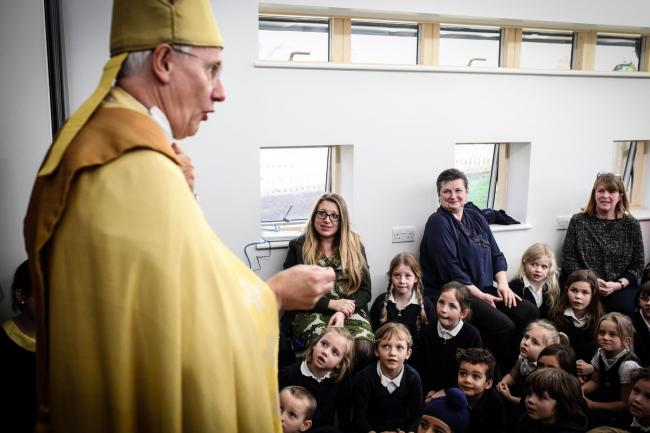 The Bishop of Dorchester, the Rev Colin Fletcher, helps to open the practical skills building at Dr South's School