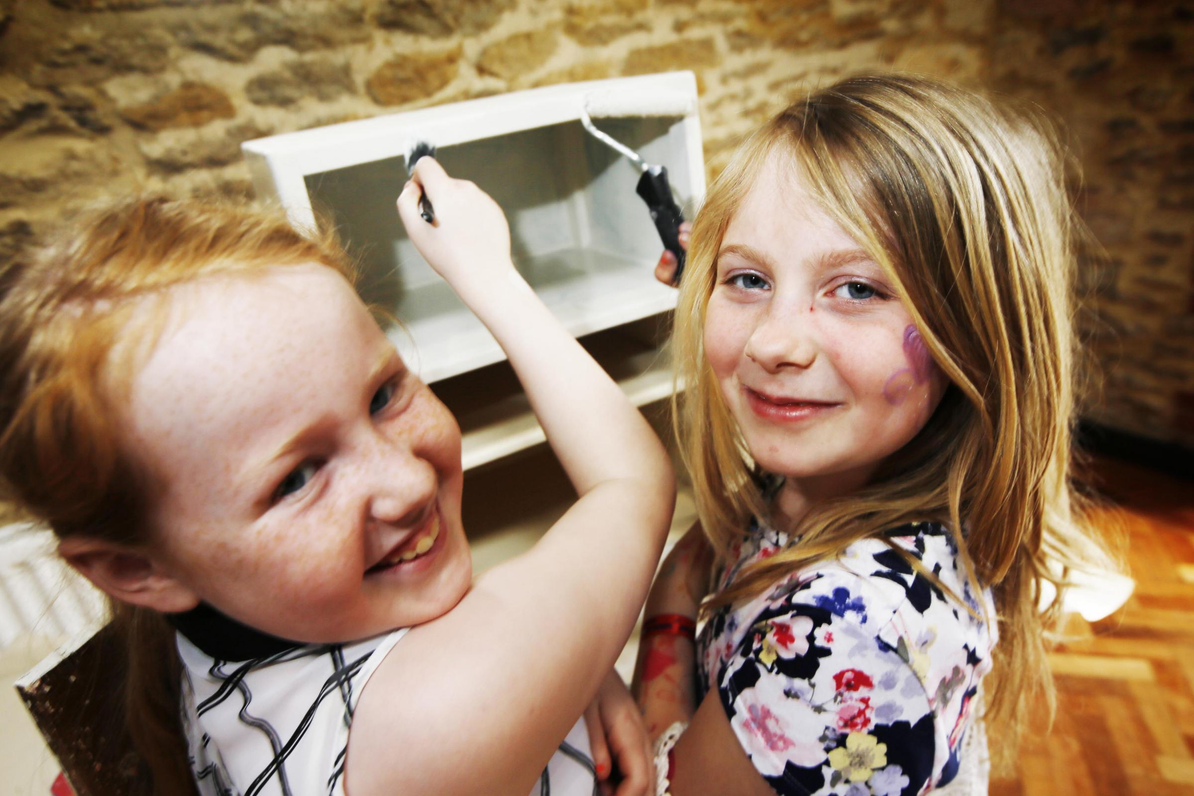 UPCYCLING: Sarah McNally-Salmon, 11, left, and Rosie Rasala, 10, take part in the event