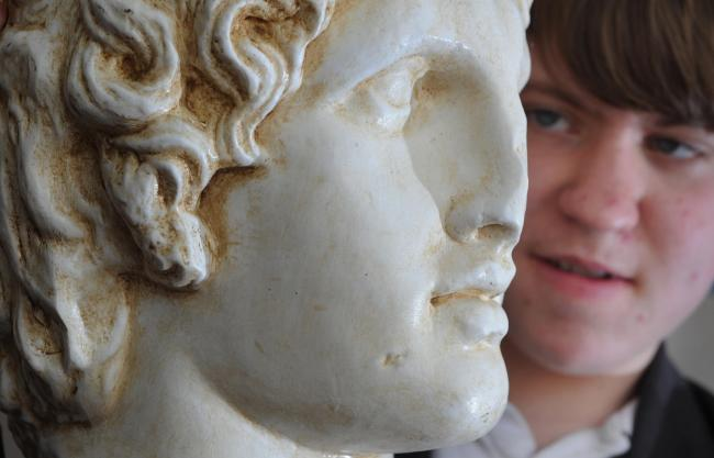 Cheney School pupil Barnaby Evans, 14, with a bust of Alexander the Great