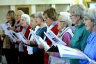 Kidlington Community Singers, pictured in rehearsal at the village's baptist church, have sent out a rallying cry for more men