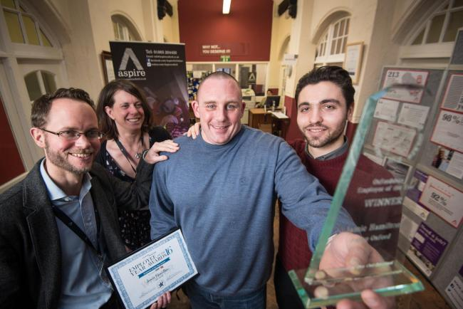 Employment and development worker Jamie Hamilton clutches his awards alongside chief operating officer Paul Roberts, senior fundraiser Helen Mariner and fundraising officer Mark Gallagher