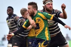 BREACH: James Stevenson-Wright, pictured playing for Henley (yellow and green) earlier this season, has been reprimanded for appointing an unregistered agent when signing for the club Picture: Aaron Bayliss