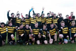 UNDER 14 PLATE WINNERS: Wallingford celebrate after their victory over Bicester Picture: Melita Kyle
