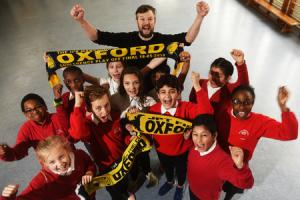 Oxford United's supporter's trust has provided 38 children from Rose Hill Primary School tickets to watch Oxford United at Wembley on Sunday.Back Class teacher Peter Mallam with a few of the 38,front left is Lucy-May Blackford and far right is Preciou