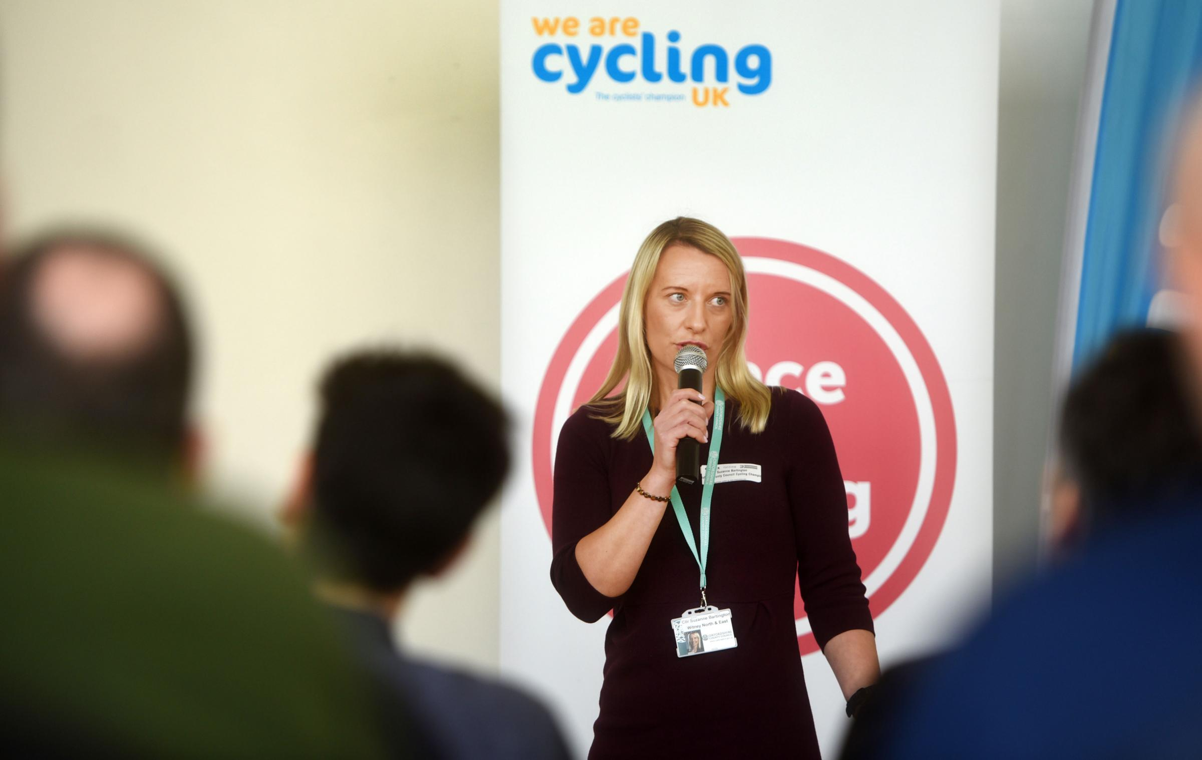 Suzanne Bartington speaking at a cycling event.