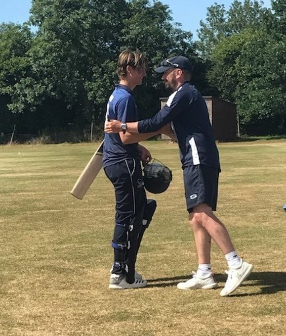 OUTSTANDING: Oxon Under 15s Will Hammersley is congratulated on his 71-ball century against Wiltshire by coach Duncan Green