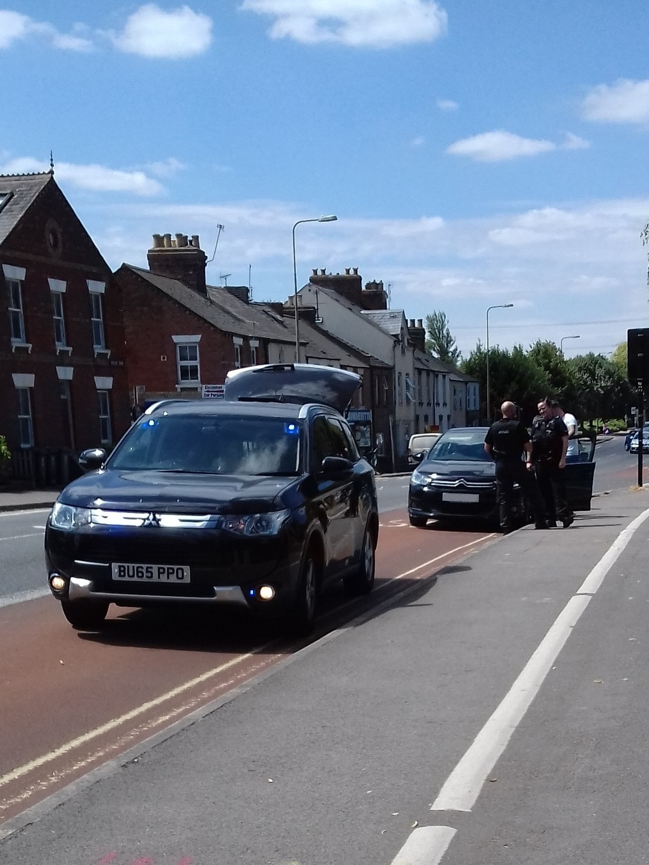 Police in an unmarked vehicle stopped a car on Botley Road, Oxford, on Tuessday, July 10, 2018. Picture: Pete Hughes