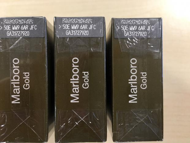 thisisoxfordshire: These packets of Marlboro Gold cigarettes look like the real thing but each packet should have unique code. If you see the identical code on two or more packets, it's highly likely they are counterfeit.