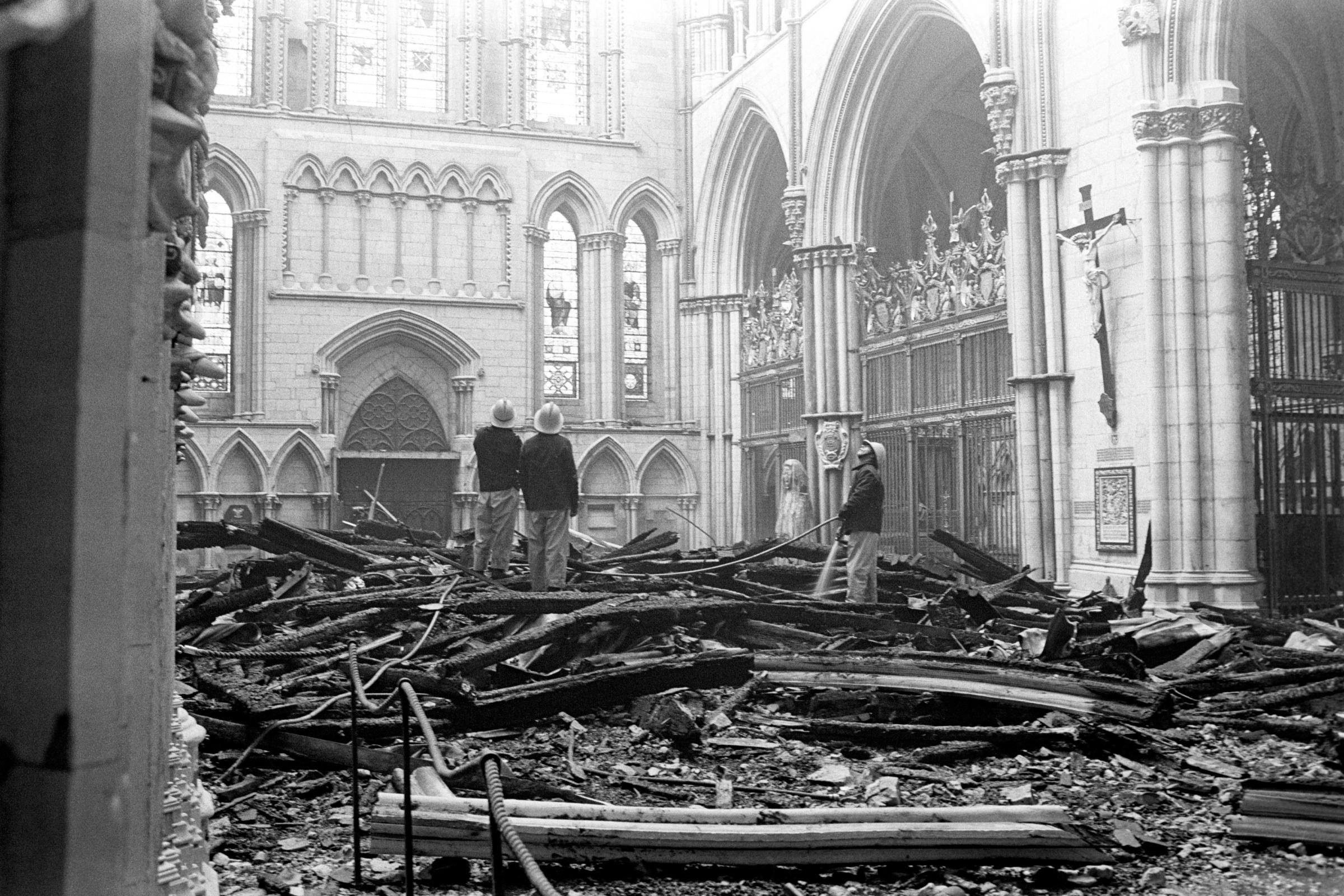Firefighters survey the damage to the South Transept of York Minster after the blaze in 1984