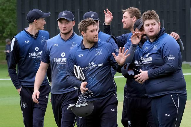 Captain Jonny Cater (centre) leads his team from the field after Oxfordshire beat Shropshire in the first match of the day Picture: Ric Mellis