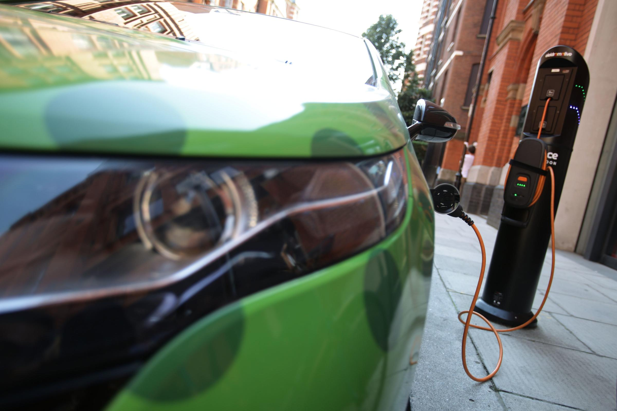 An electric vehicle is plugged into a charging point